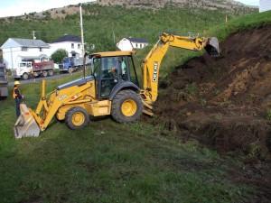Enlèvement du sol contaminé dans une pente