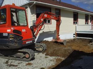 Enlèvement du sol contaminé près d'une résidence